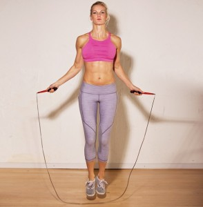 Female athlete using jump rope as her strength training