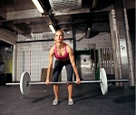 Female crossfit performing doing deadlift exercise with weight bar