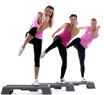 young group women training on stepper and smile isolated